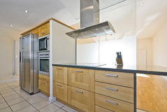 Brand new contemporary open plan kitchen. With modern appliances and double amirican style fridge Stock Photo