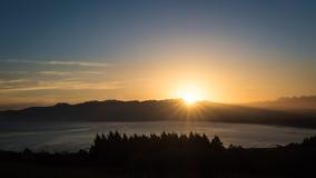 Peaceful landscape image of sunrise above mountain royalty free stock image