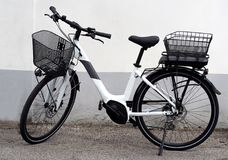 Brand new electric bicycle, or e bike, for women. The new battery is thin enough to be placed under the back basket.  stock photos