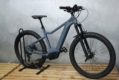 Brand new electric mountain bike, or e bike, assembled . Brand new electric mountain bike, or e bike, on a pallet. Assembled stock image
