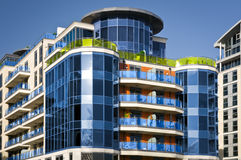 Brand new executive apartments. Modern, new executive flats and offices with deep blue summer sky and copy space royalty free stock images