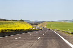 Brand new freeway road in Germany. Motorway between green fields. In summer day royalty free stock photo