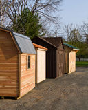 Brand new garden sheds. Garden sheds straight from the workshop lined up for transport on an early spring morning Stock Photography