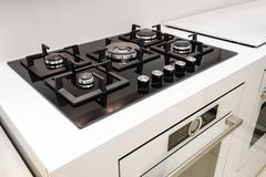 Brand new gas stove and embedded oven Stock Photo