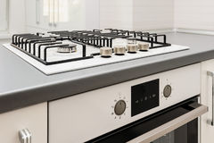 Brand new gas stove and embedded oven Royalty Free Stock Photography