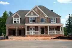 A brand new home under construction. Waiting for the finishing touches royalty free stock photo