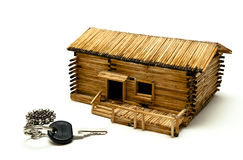 Brand-new house. A key for new house next to a wooden follly Royalty Free Stock Photo