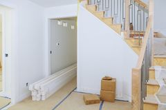 Brand new house construction interior room with unfinished wood floors. Partially unfinished. railing on a new home Royalty Free Stock Images