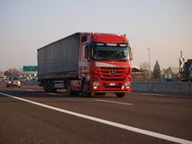 Brand new mercedes actros truck on red color Royalty Free Stock Photos