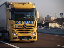 Brand new mercedes actros truck on yellow. Logistic container on yellow mercedes new actros truck on italian motorway A4 on Milano direction Stock Images