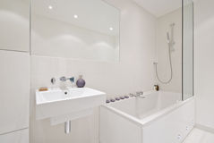 Brand new modern bathroom. Newly built modern bathroom with contemporary bath tub and wash basin Royalty Free Stock Photos