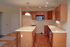 Brand New Modern Kitchen. This brand new kitchen is ready to move in and add your own appliances Stock Photo