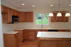 Brand New Modern Kitchen 2. This brand new kitchen is ready to move in and add your own appliances Stock Images