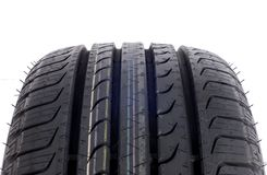 Brand new modern summer sports tire. Fragment A brand new modern summer sports tire Royalty Free Stock Image