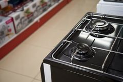Brand new never used gas stove in appliance retail store.  stock image