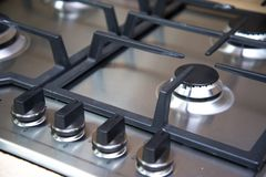 Brand new never used gas stove in appliance retail store.  stock photo
