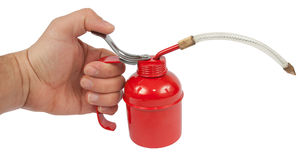 Hand and Oilcan isolated with path Royalty Free Stock Images