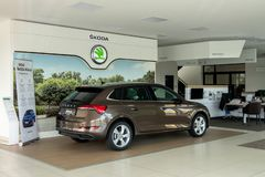 Brand new Skoda Scala car inside a dealership building stock image
