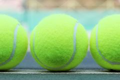 Brand new tennis balls arranged in a row Stock Photography