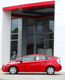 Brand new Toyota Prius outside dealership. Beautiful 2011 Toyota Prius is parked outside front of dealership Royalty Free Stock Images
