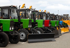 Brand new tractors in a line Stock Photo