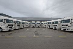Brand new trucks parked for delivery to a client Stock Photos