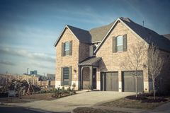 Brand new two story residential house in suburban Irving, Texas, USA stock photos