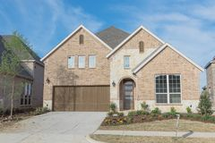 Brand new two story residential house in suburban Irving, Texas,. Brand new two story residential house, newly constructed and freshly built with landscaped yard Royalty Free Stock Photos