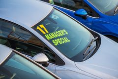 Managers Special Car Deal. Brand New Vehicle with Managers Special Sign on a Windshield. Car Dealer Lot Royalty Free Stock Photography