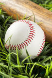 New White Baseball in green grass Royalty Free Stock Photo