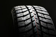 Brand new winter tire. Royalty Free Stock Photography