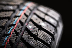 Brand new winter tire. Royalty Free Stock Images