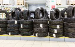Brand new winter tires stacked up for sale in the hypermarket Stock Photos