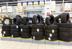 Brand new winter tires stacked up for sale in the hypermarket Stock Image