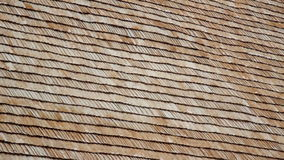 Brand new wooden roof A really close footage of the close-up view of the cabin cedar wooden shingle shake roof stock footage