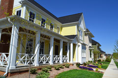 Brand New Yellow New England Style Cape Cod Dream Home. With Large Front Porch Stock Images