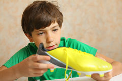 Brand new yellow soccer boots. Boy with new soccer boots Royalty Free Stock Images