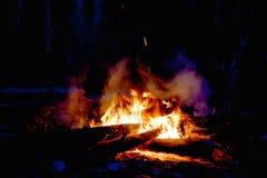 Brand och vedträ Arkivbild