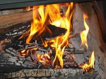 Brand op een open haard Stock Foto