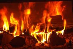 Brand in open haard stock fotografie