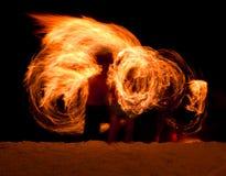 Brand Poi op het strand stock fotografie