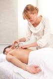 Brand som kuper akupunkturbehandling arkivfoto