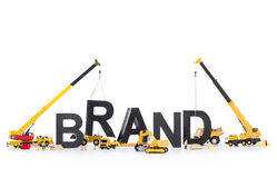 Brand start up: Machines building brand-word. Stock Photo