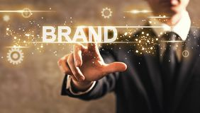 Brand text with businessman. On dark vintage background royalty free stock photo