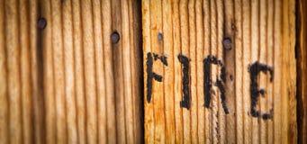 Brand utskrivavet trä Arkivbild