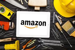 Brand web page on the display. Amazon diy tools background woodwork project stock images