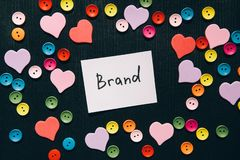 Brand - word on black background with colorful hearts decorations, business concept stock images