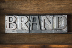 Brand. Word made from metallic letterpress type on wooden tray royalty free stock photography