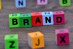 Brand word on table. Brand word on wooden table stock photo