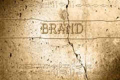 Brand. Word brand on wall with egyptian alphabet made in 2d software Stock Image